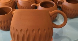 Carved mugs with finger loop handles from Fern Street Pottery. These will be gla...