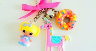 Cute polymer clay keyring with polymer clay donut, bell, dorky unicorn, and doll great accessorie for your bag etc