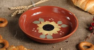 Plate of red clay with a picture of a sunflower, dish, brown plate, Pottery, ceramic, handmade