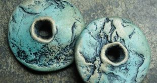 Polymer clay donut disc beads with rock patterns in shades of turquoise and gold...