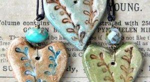 Pottery heart necklaces. This inspires me to cut hearts out of clay and get them...