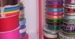 Ribbon spool organizer ~ take it further for my collection, drill holes in a laz...